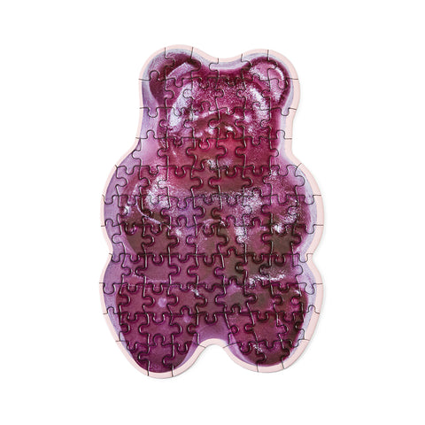An assembled puzzle in the shape of a purple gummy bear.