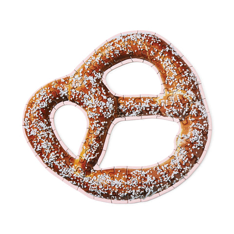 An assembled puzzle in the shape of a soft pretzel.