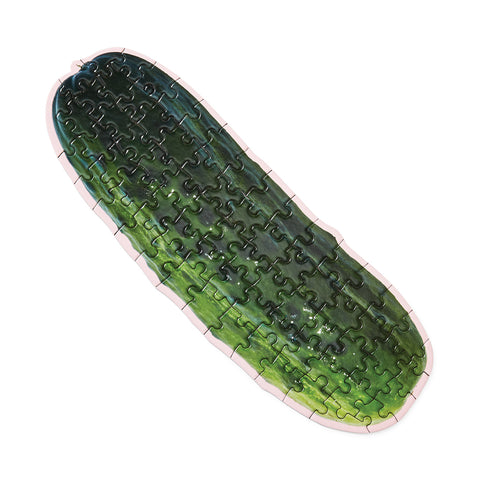 An assembled puzzle in the shape of a pickle.
