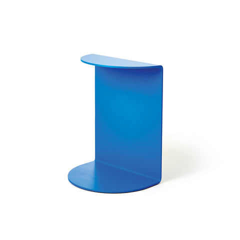 A photograph of a single blue Reference Bookend standing up on its tall side, facing out at a forward angle