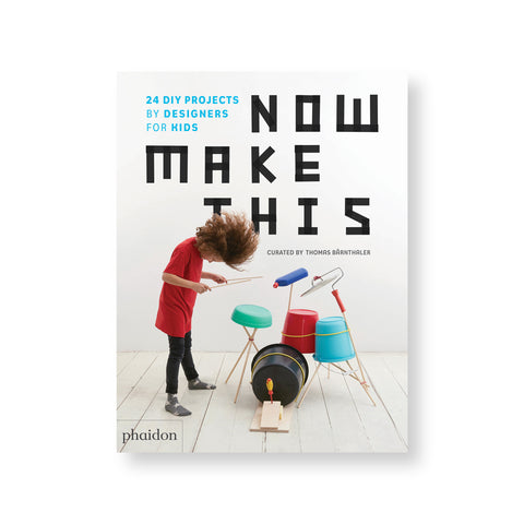 Book cover with photograph of a child with long wavy hair and red shirt rocking out on a homemade drum kit. Title in black tape like font at top