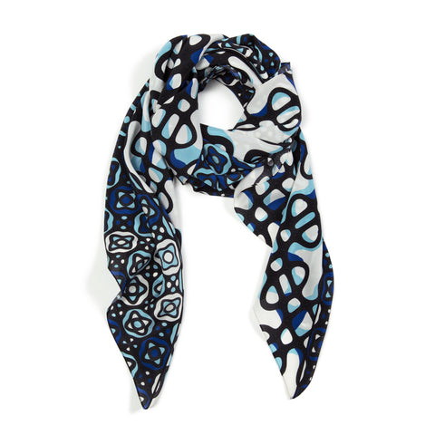 Square silk scarf features blue and black vibrant patterns of sound over a white background.