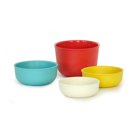 A set of four measuring cups in various colors and sizes