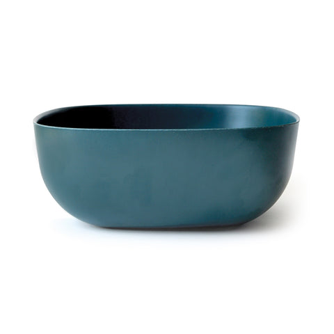 A large square-shaped salad bowl in dark blue