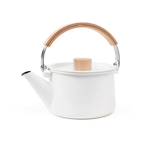 Side view of a bright white minimalist enamel Kaico Kettle on a white background with a wide, straight-sided cylindrical body, angled pour spout, arced steel carrying handle with a wooden grip, and flat lid with a light wood, easy-to-grasp cylindrical knob.