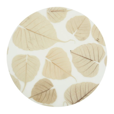 A translucent and round placemat detailed with skeleton leaves