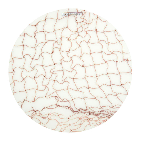 Round translucent placemat with fishnet detail in brown
