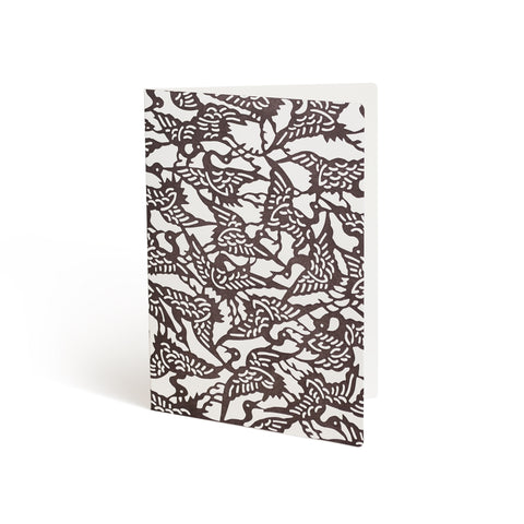 Printed in brown ink against a white background, the front of a card is covered in a repeating bird pattern that bleeds off the edges.