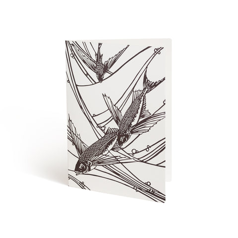 Printed in brown ink against a white background, the front of a card has a drawing of three flying fish with stylized waves bleeding off the background.