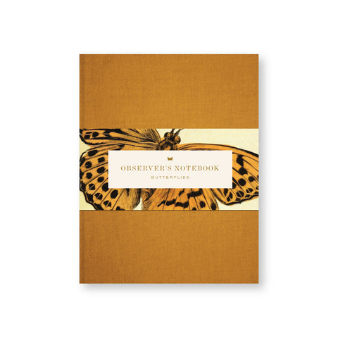 Ocher canvas notebook cover with belly band with ocher title in vintage font surrounded by an illustration of a similarly toned butterfly