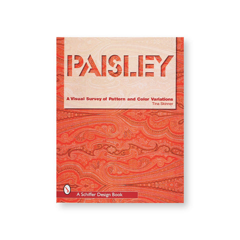 Book cover with orange and rad paisley pattern overlaid with title cut out of a transparent white field