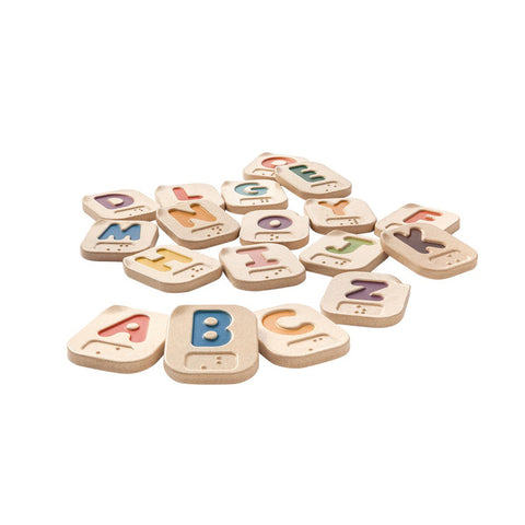 Braille Alphabet Tiles made out of rubberwood. Each tile features a colored letter with embossed braille underneath the letter.