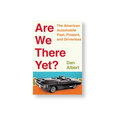 Beige book cover with vertically stacked title in red letters to the left of subtitle and author name in orange and green. Below is an image of a sleek black car on an orange road