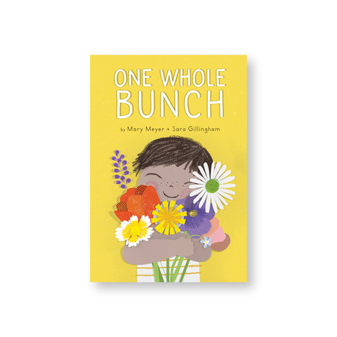 Yellow book cover with freckled dark haired boy holding a bunch of colorful flowers