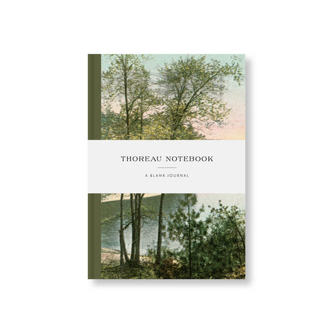 Notebook with forest green spine and colorized vintage photograph of a lake and surrounding forest. White belly band with title in vintage font