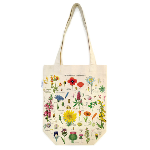 Beige tote bag with brightly colored botanical illustrations and two long handles