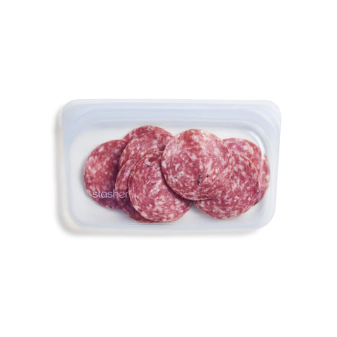 A clear silicone snack-sized resealable bag filled with pepperoni slices.