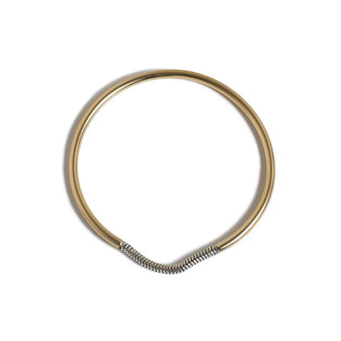 Chained Bangle; Thin gold filled bangle with an interruption of silver that is slightly loose in form