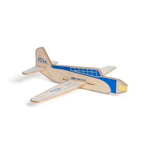 Sitting on a white surface, an image of an assembled turbo flyer airplane made of natural wood with blue accents and logo on the tail.