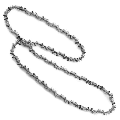 A long necklace that can be wrapped twice around the neck. Made from stainless steel beads shaped as halves of a sphere.