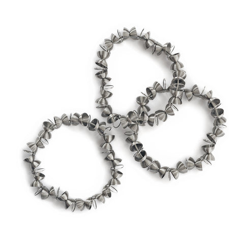 Three bracelets with beads shaped as halves of a sphere assembled with rings, hold together by a stainless steel spring.