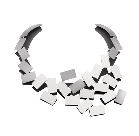 Mirror-polished u-shaped choker necklace with randomly placed rectangular shapes making up its structure, shot on a white background.