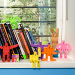 Nine Micro Cubebots posed in various positions on a bookshelf.