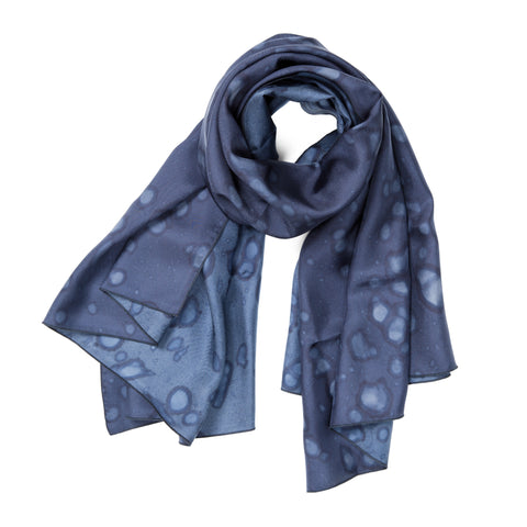 Made By Rain Scarf Large in Dark Blue, looped at the top with the ends fanning out. The material is silky, and splattered with raindrops.