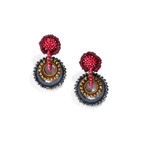 A pair of drop hoop-style earrings in Graphite, Copper and Red made from woven and wrapped silk thread and faceted crystal beads. Each earring has a tightly woven ball of red iridescent beads surrounded by a tightly woven red-silk ring at the top, connected to a red beaded hoop which passes through the opening and supports two nested hoops, a smaller copper-colored hoop and a larger graphite-colored hoop, each rimmed with matching iridescent crystals.