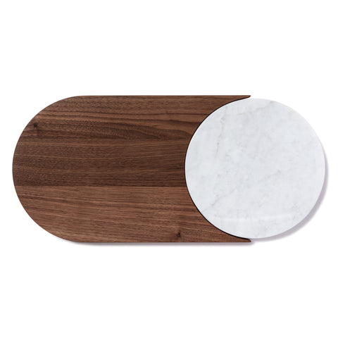 Cylindrical  shaped walnut cutting board with a round marble cutout on right side.