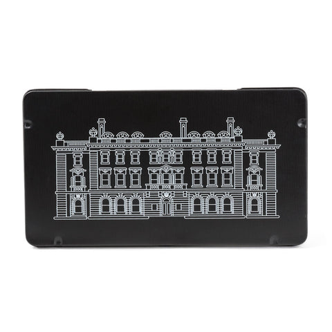 Facing forward, the front on a rectangular black tin has the Cooper Hewitt mansion printed in white outline.