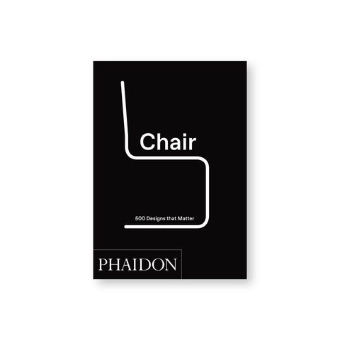 "Small black book cover with a white line forming a minimalist chair in profile. The word ""Chair"" in white on the seat of the chair and ""500 Designs that Matter"" on the base."