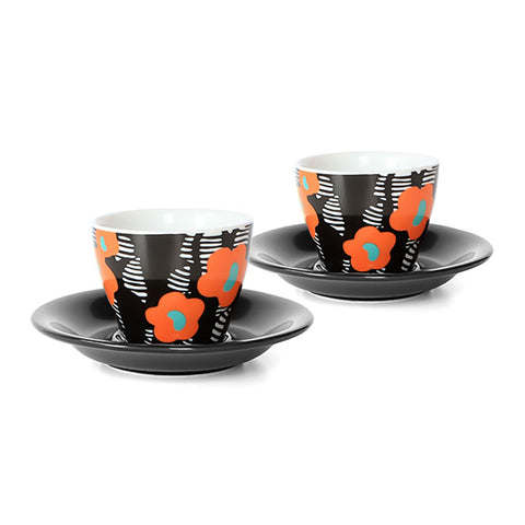 A pair of floral printed espresso cups and saucers. Each cup features a orange floral print on a black and white background. The saucers are black