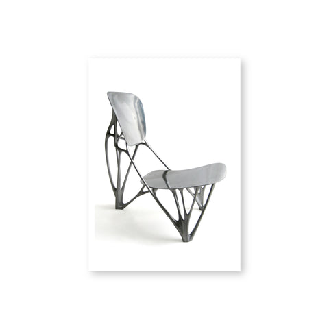 An aluminum chair with skeletal frame and solid aluminum seat and back rest.