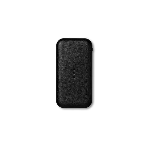 Black, rectangular Carry charger with rounded corners, a pebbled texture, and three vertically aligned charging dots in the middle.
