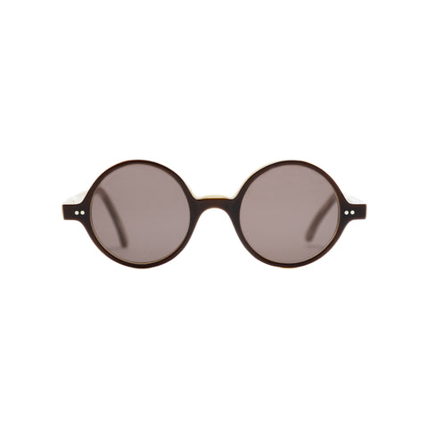 Round glasses with thin brown frames and warm-gray lenses. Middle hinges and rounded bridge.