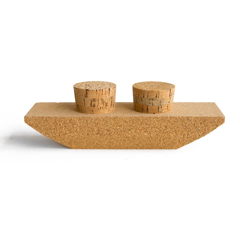 Mini barge boat made out of cork. Two removable cork stoppers inserted into the top of the boat.