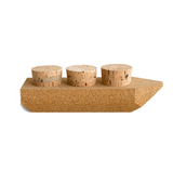 Mini cargo boat made of cork featuring three insertable cork stoppers on top of the boat.