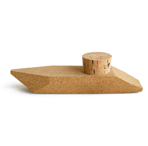 Mini speedboat made out of cork. A removable cork stopper is inserted into the top of the boat.