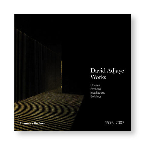 A dark book cover featuring an image of Adjaye's project. Most of the cover is black, the only the floor and the right wall is visible. The title and publisher's logo is designed using white font.