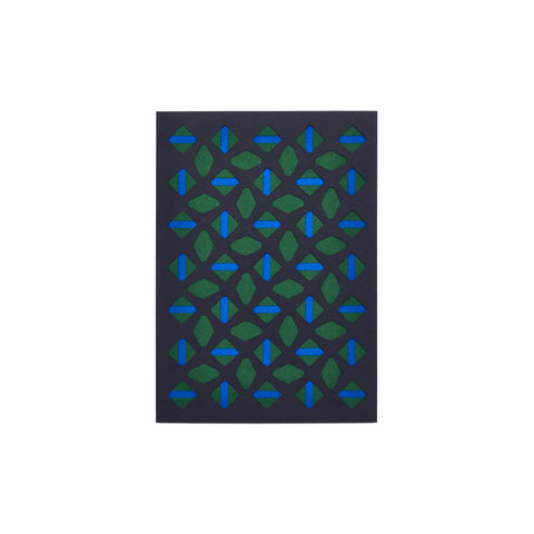 Navy greeting card with geometric cutouts: rows of alternating diamond shapes with stripes down the center, in dark green and blue.