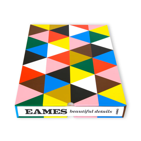 "Boxed book, view from spine. Spine is white with black text reading ""Eames beautiful details."" Box has an all-over tessellation of brightly colored triangles."