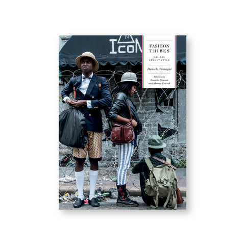 Fashion Tribes book cover featuring a photograph of three people in unique outfits and hats in front of barbed wire and a brick wall.