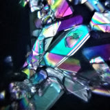 Microscopic detail of clear and iridescent prisms.
