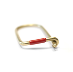 Wilson brass key ring enameled in red.