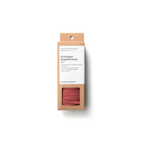 Rectangular, natural cardboard package with white label for the All Purpose Spaghetti Scrub, window-cut out reveals scrubber made up of many strips of coral-colored, textured material.