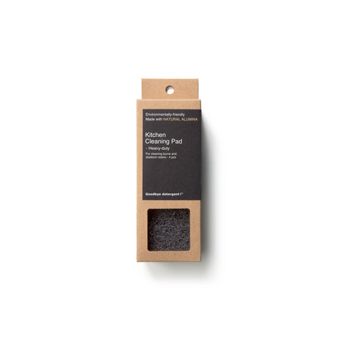 Rectangular, natural cardboard package with black label for the Keatchen Cleaning Pad Heavy Duty, window-cut out reveals black, textured scrub pads.
