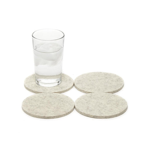 Heathered grey felt coasters shown in quad on white, one has clear glass half full of water on it.