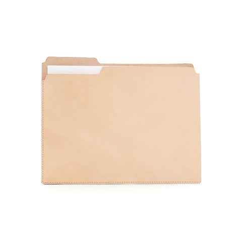 Natural leather holder shown on white background with some white papers showing near tab cut-out.