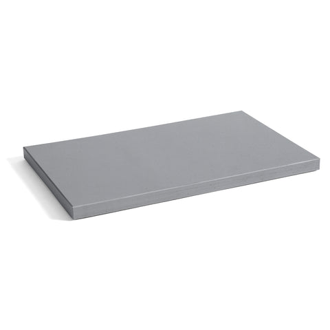 Rectangular, matte gray plastic cutting board.